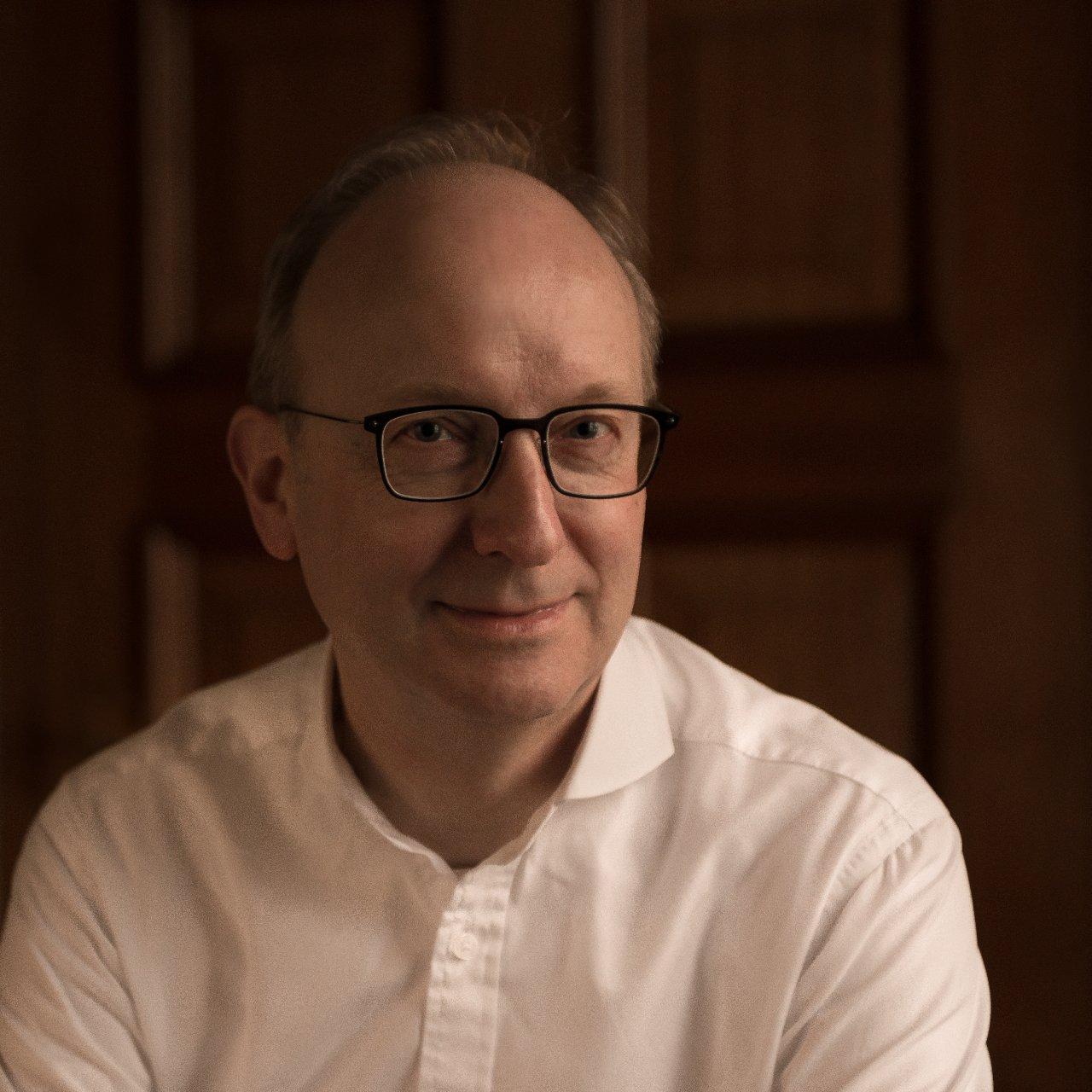 Portrait of David Titterington, smiling
